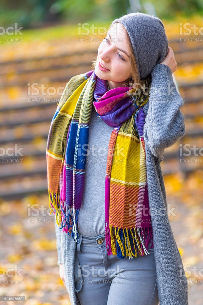 Woman walking at park in autumn Lizenzfreies stock-foto