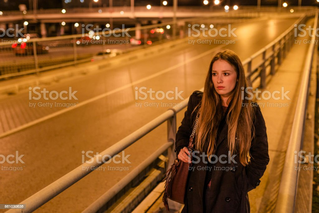 Woman Walking at Roadside stock photo
