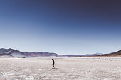 Silhouette of womanan exploring the volcanic landscape in the middle of Atacama region in Chile