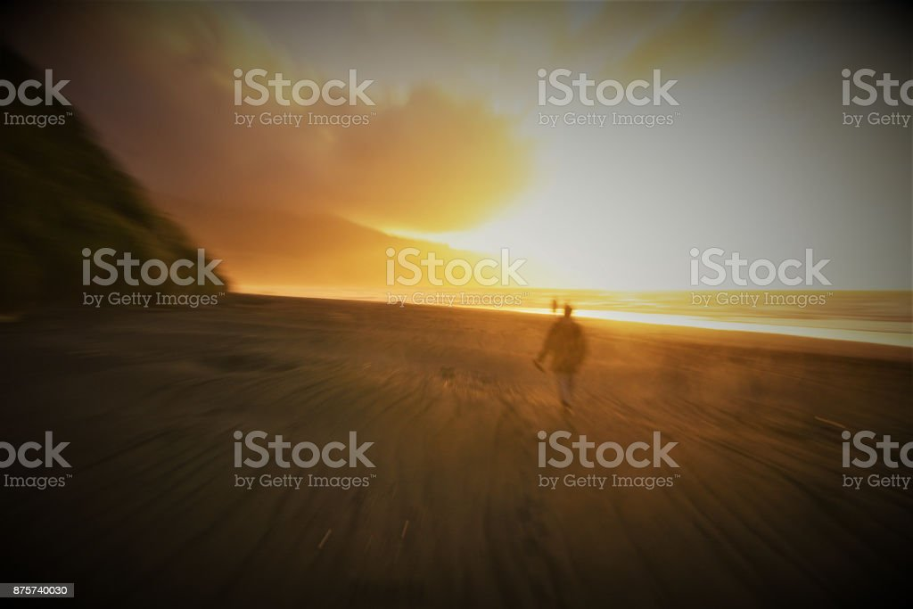Woman walking at the Beach in a blurry, rushed athmosphere stock photo