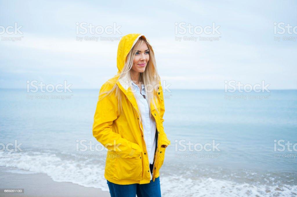 Woman walking at the beach stock photo