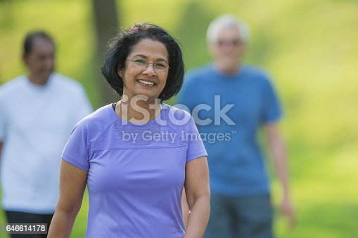 istock Woman Walking at the Park 646614178