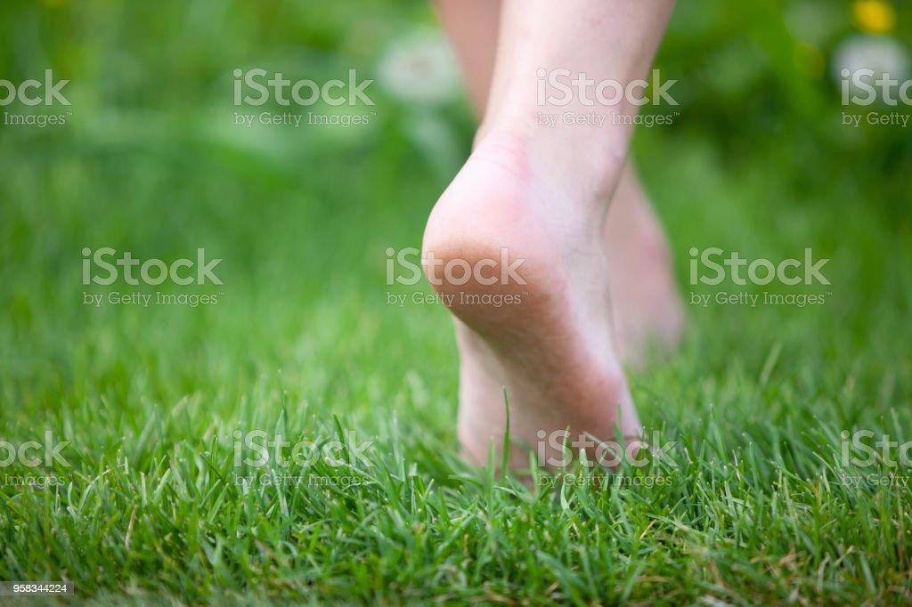 Woman walking barefoot stock photo