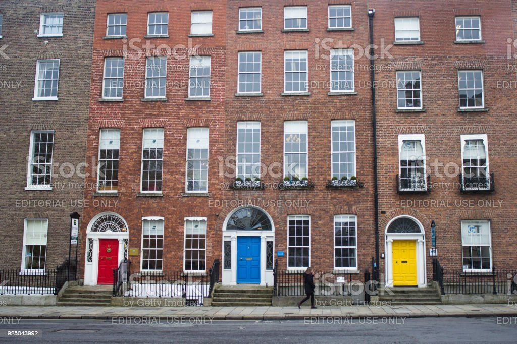 Woman walking by apartment building in Dublin Ireland stock photo