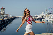 Woman walking by the marina