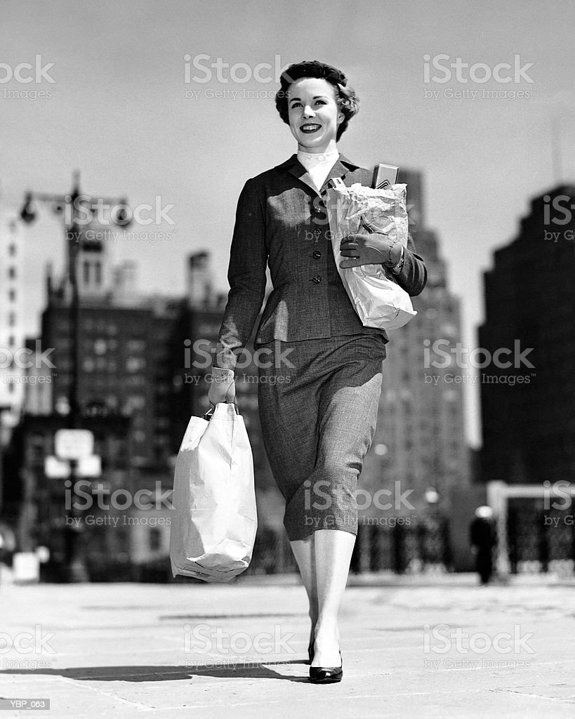 Woman walking, carrying bag royalty-free stock photo