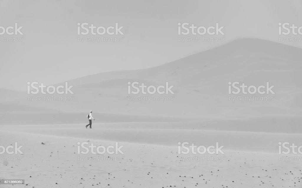 Woman walking desert stock photo
