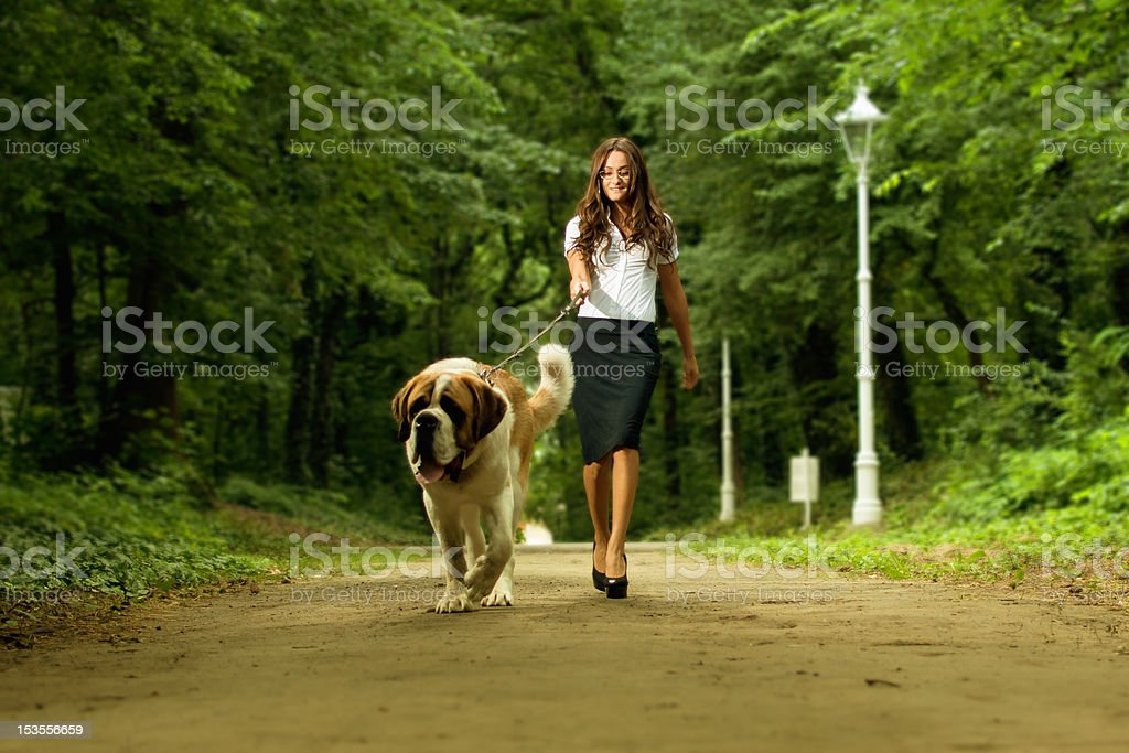 Woman walking dog royalty-free stock photo