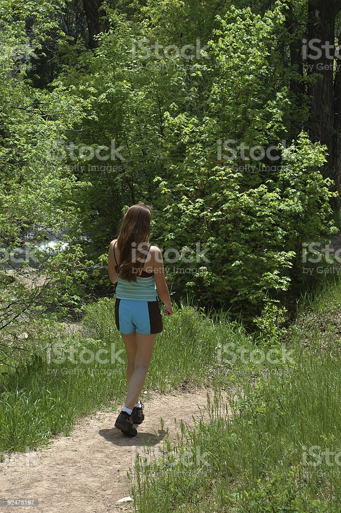 woman walking down the trail royalty-free stock photo