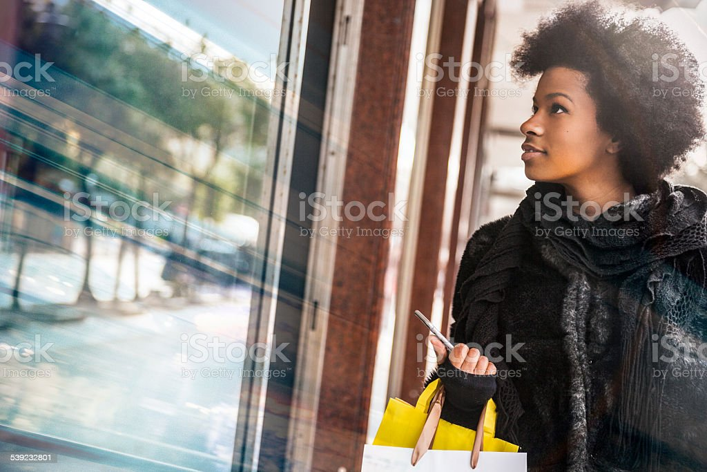 Woman walking for shopping in downtown stock photo