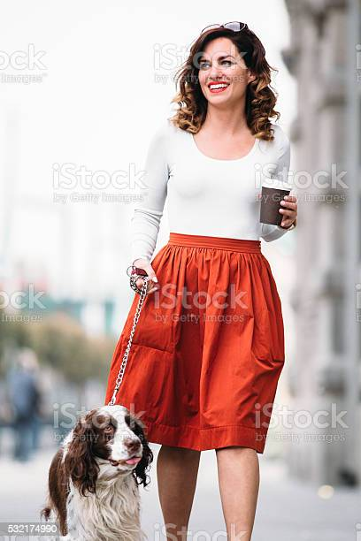 Woman walking her dog picture id532174990?b=1&k=6&m=532174990&s=612x612&h=qsqze9suf gczorc8u60yroj4lbm5aw9qss6sc1d2g8=