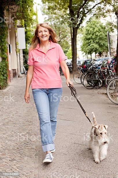 Woman walking her fox terrier picture id155444993?b=1&k=6&m=155444993&s=612x612&h=uwg9bz6dxp9bsbuf6zpasz4mtkeukj5rzswxndcwxp8=