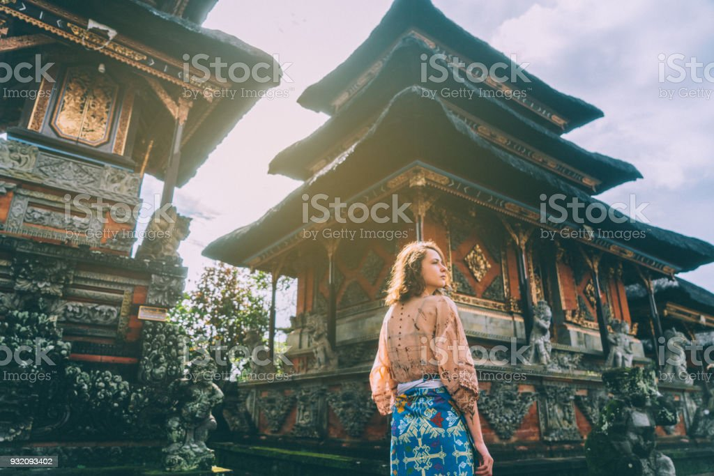 Woman walking in Balinese temple stock photo