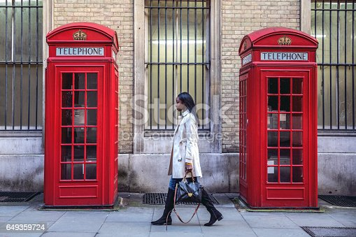 Outdoor walks, one young black woman walking in Central London for shopping