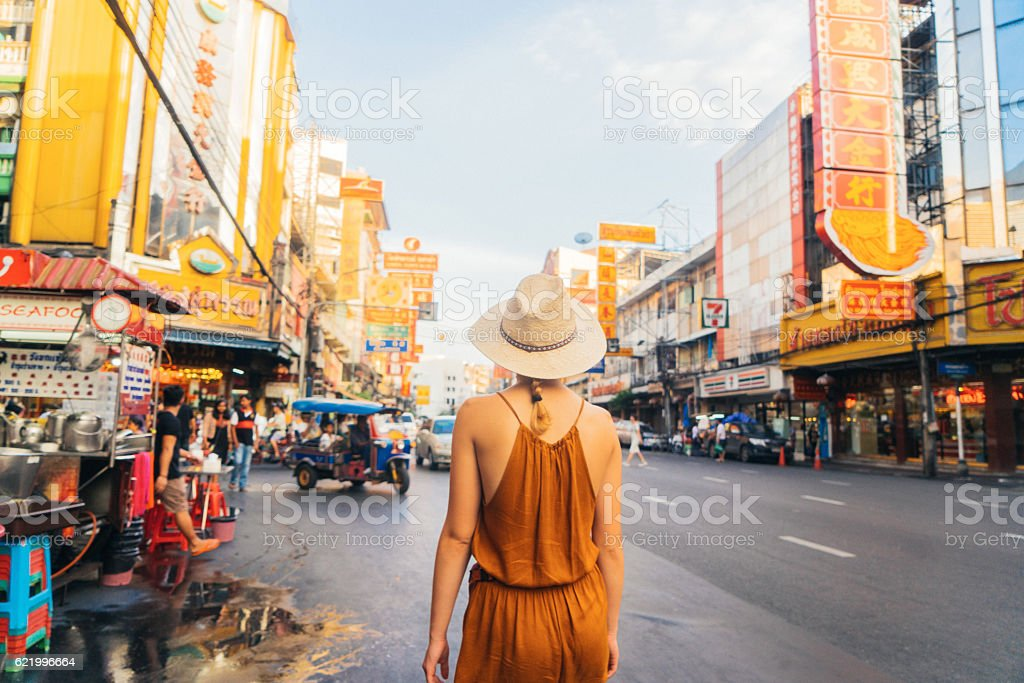 Woman walking in Chianatown stock photo