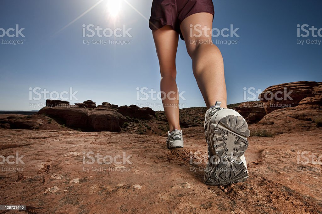Woman Walking in Desert stock photo