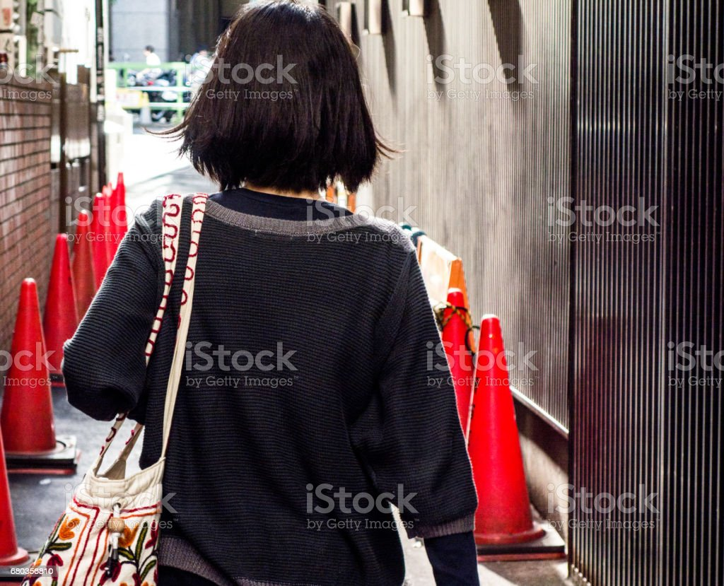 Woman walking in downtown royalty-free stock photo