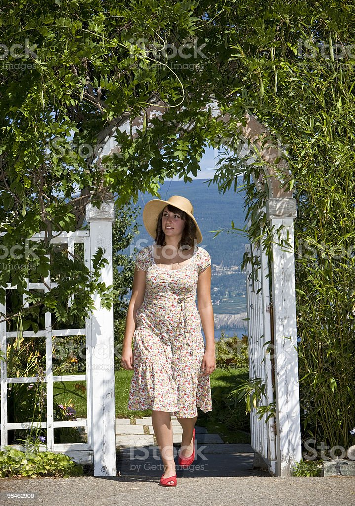 Woman Walking in Garden royalty-free stock photo