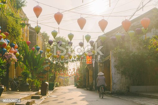 Young Caucasian woman  walking in Hoi An town in the morning