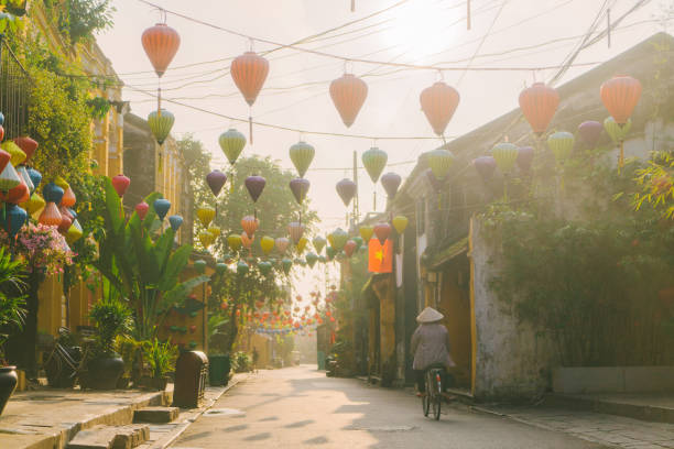 Woman walking in Hoi An in the morning stock photo