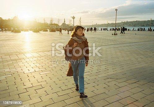 Woman walking in Istanbul in autumn