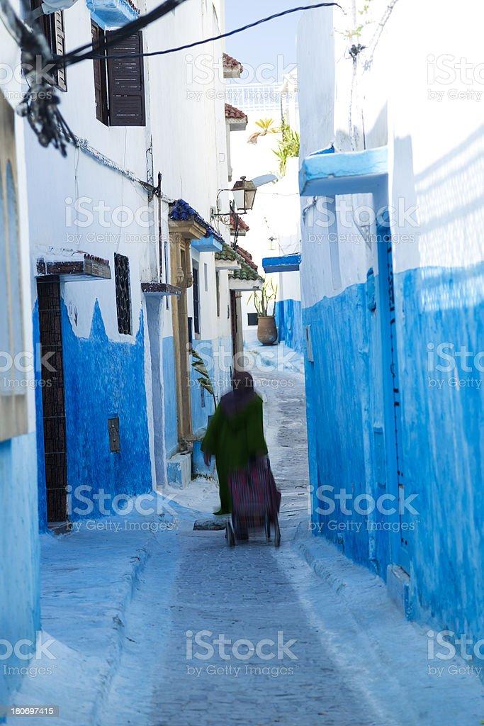 Woman Walking in Marrakech street stock photo