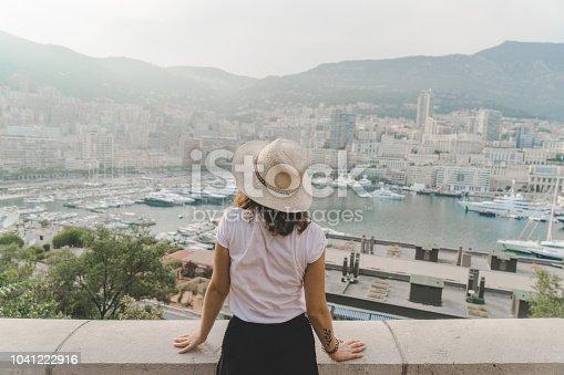 Young Caucasian woman walking in Monte Carlo, Monaco