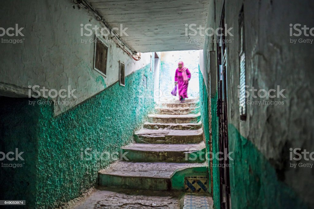 Woman walking in Moulay Idriss, Morocco stock photo