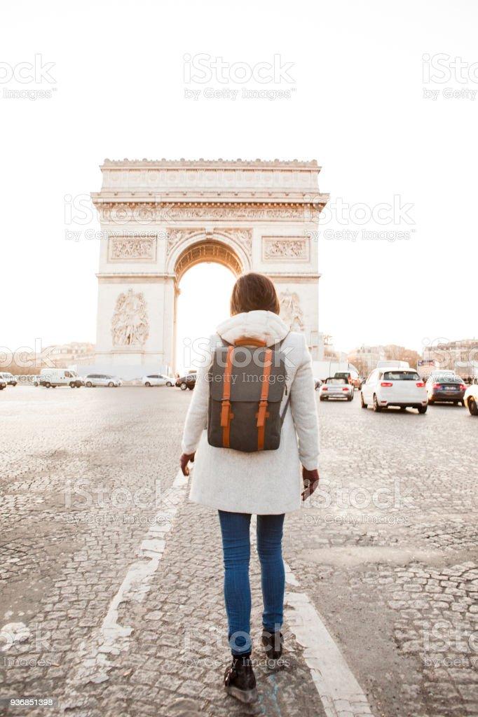 Woman walking in Paris, Arc de Triomphe stock photo