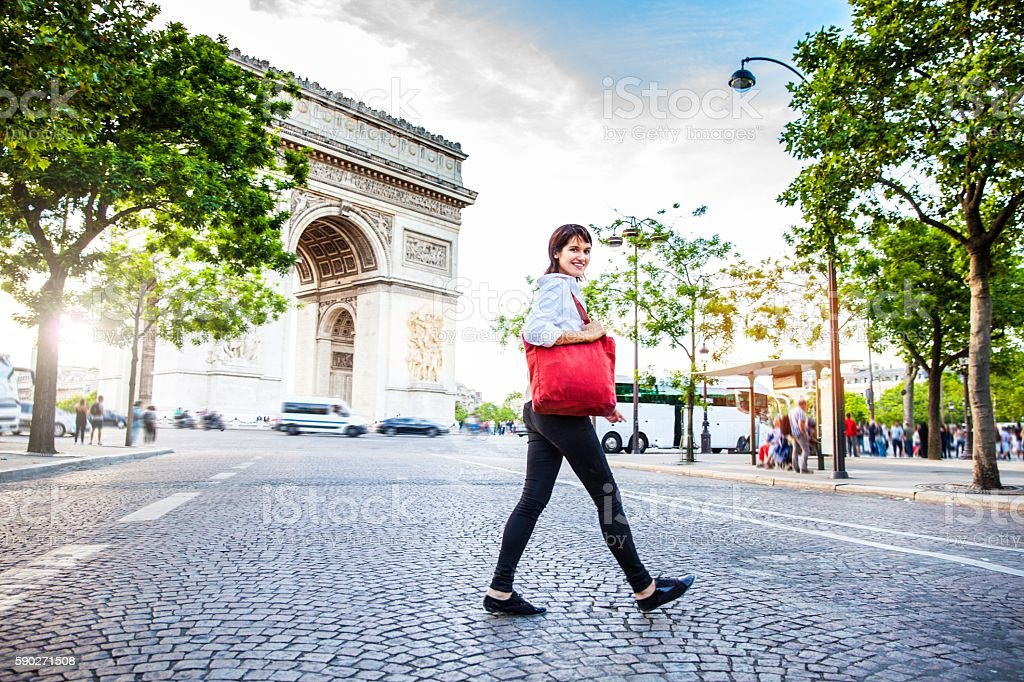 Woman walking in Paris, Arc de Triomphe surrounding area stock photo