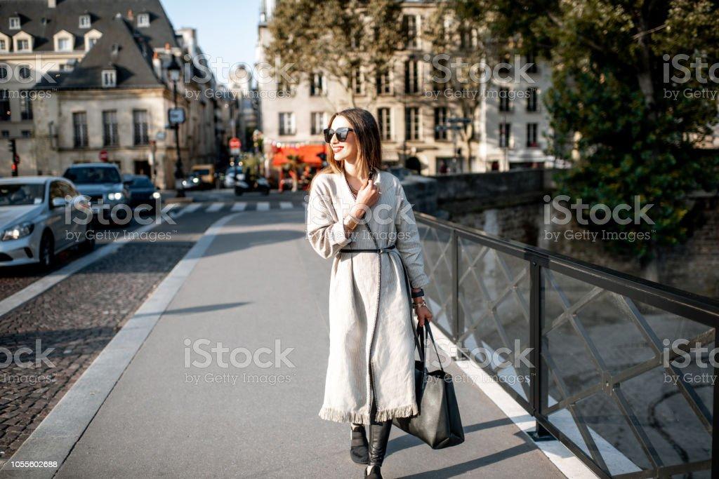 Woman walking in Paris stock photo
