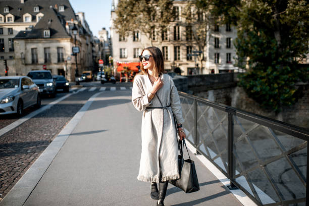 woman walking in paris - paris fashion stock photos and pictures