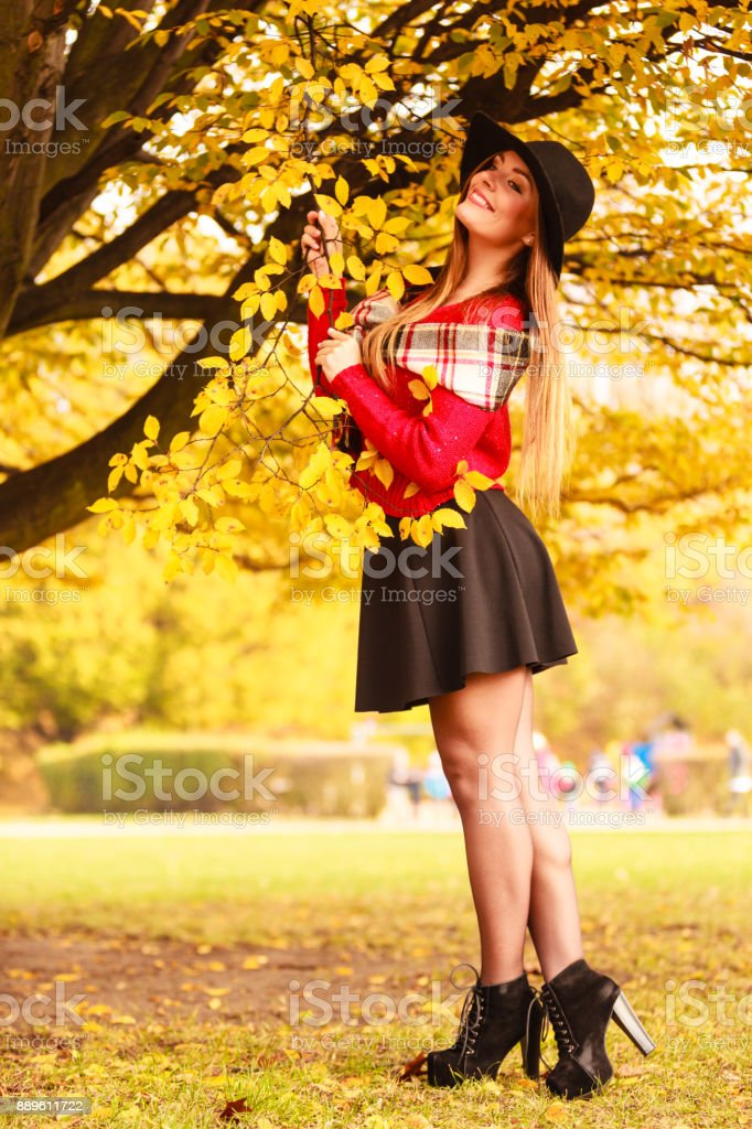 Woman walking in park during autumn stock photo