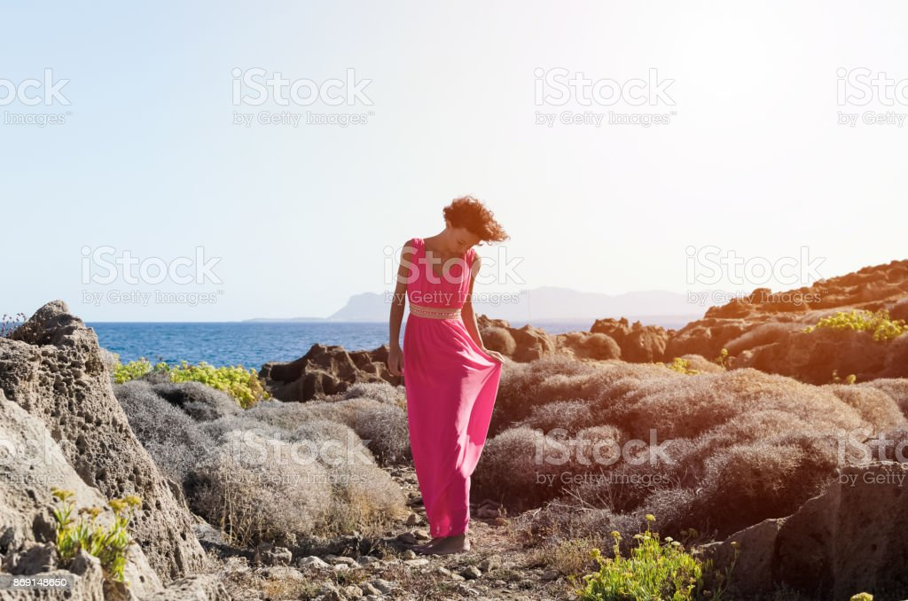 Woman walking in plant of dry shrubs stock photo
