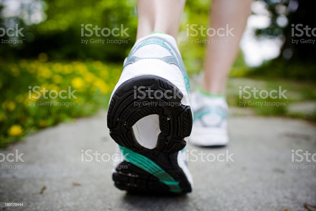 Woman walking in spring forest trail royalty-free stock photo
