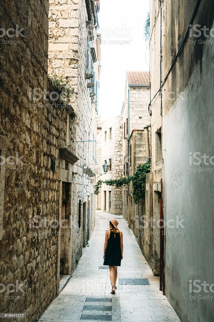 Woman walking in the old town stock photo