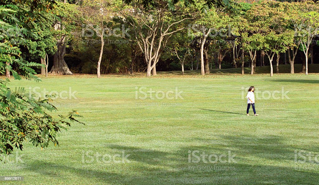 Woman walking in the park royalty-free stock photo