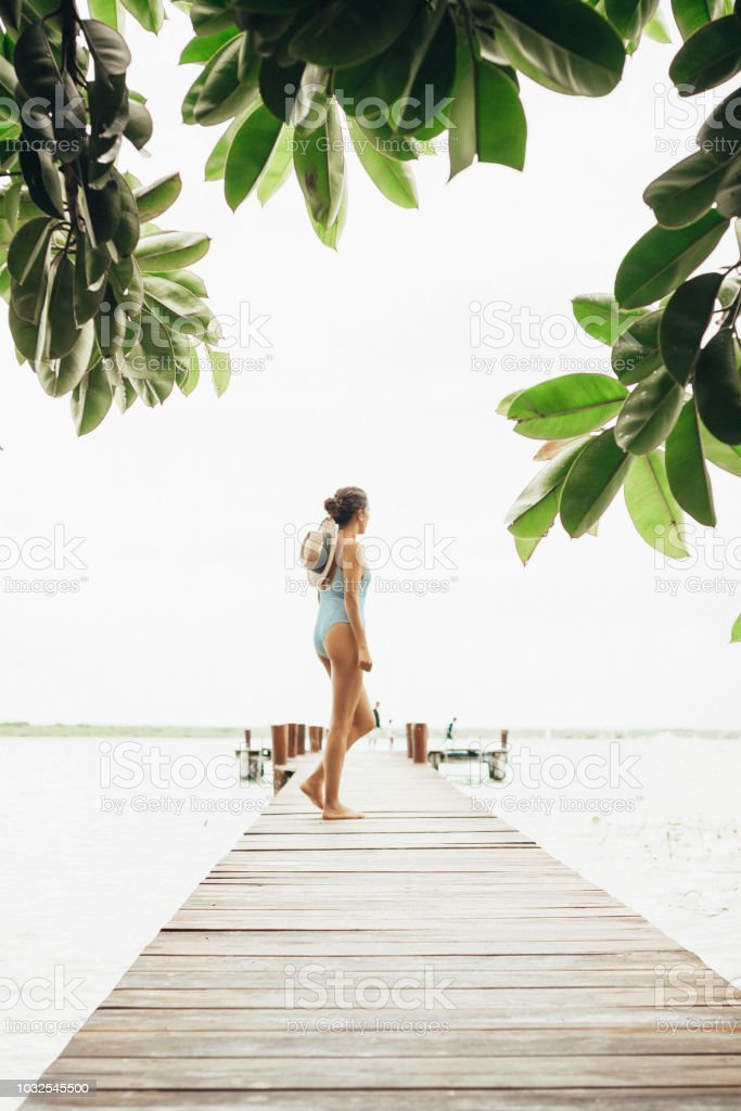 Woman walking in the rainforest stock photo