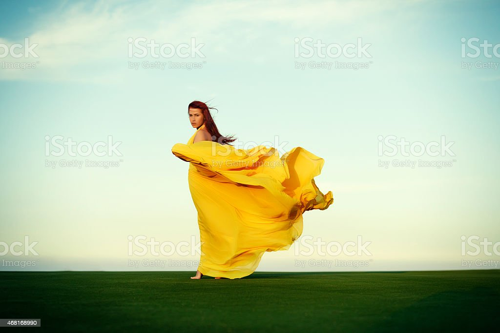 woman walking in the wind stock photo