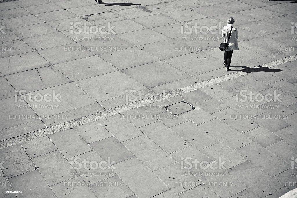 Woman Walking in Trafalgar Square royalty-free stock photo
