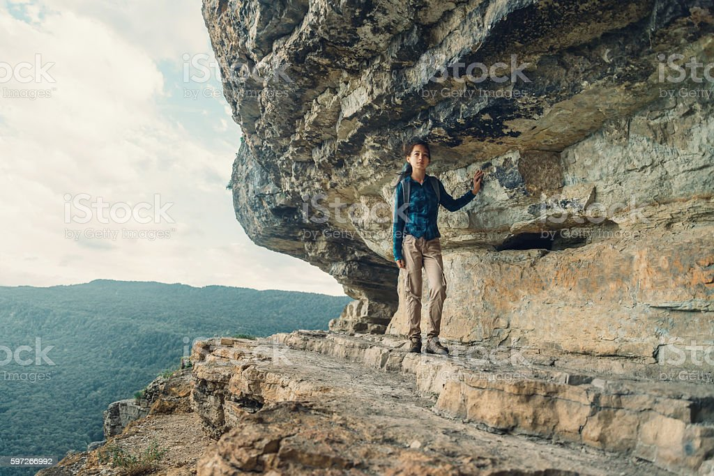 Woman walking near high cliff royalty-free stock photo