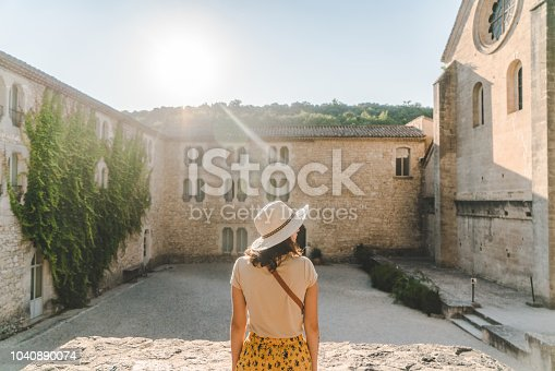 Young Caucasian woman walking near Sénanque Abbey  in Provence