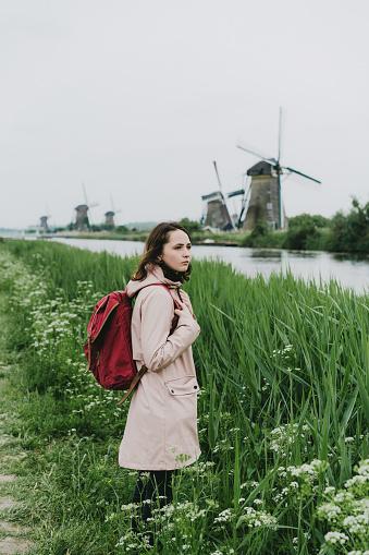 Woman Walking Near Windmills In The Netherlands - zdjęcia stockowe i więcej obrazów Architektura