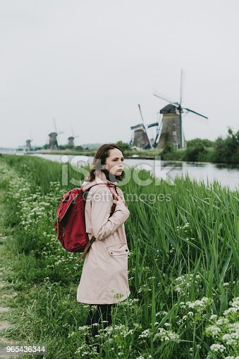 Woman Walking Near Windmills In The Netherlands Stock Photo & More Pictures of Adult