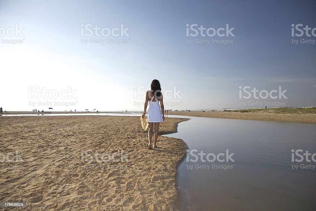 woman walking next river at beach royalty-free stock photo