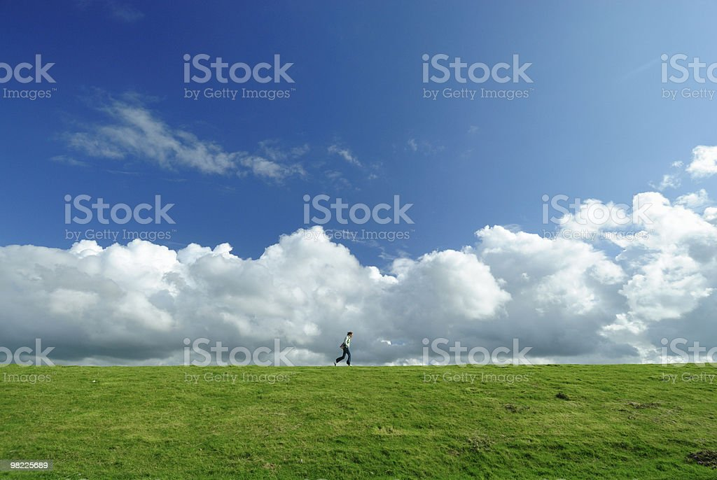Woman walking on a dyke royalty-free stock photo
