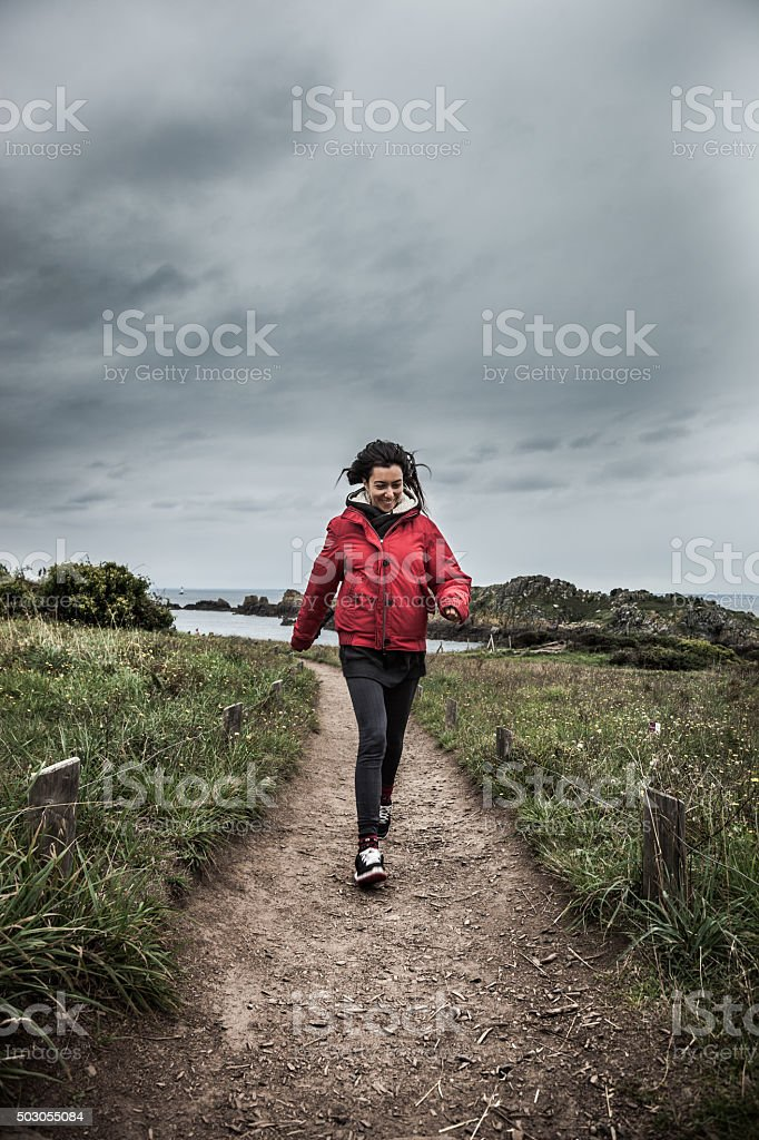 Woman walking on a path in Brittany, north of France stock photo