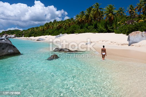 Woman walking on a perfect tropical beach, Valley Trunk, Virgin Gorda