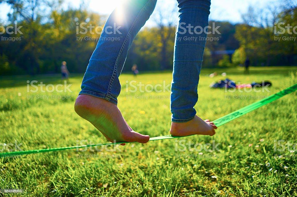Woman walking on a slackline stock photo