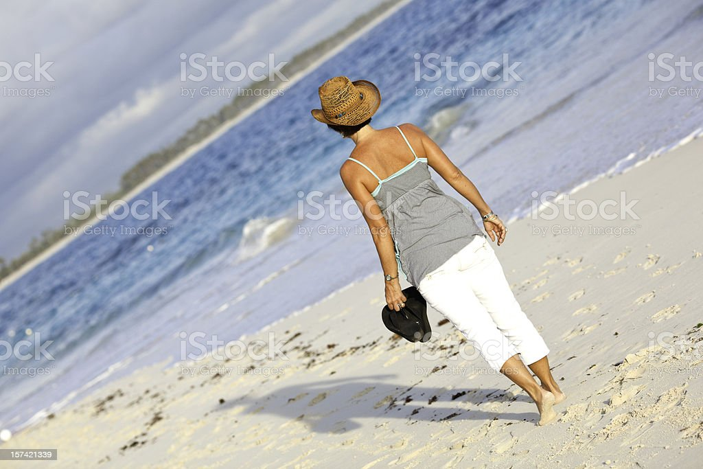 Woman walking on Beach royalty-free stock photo
